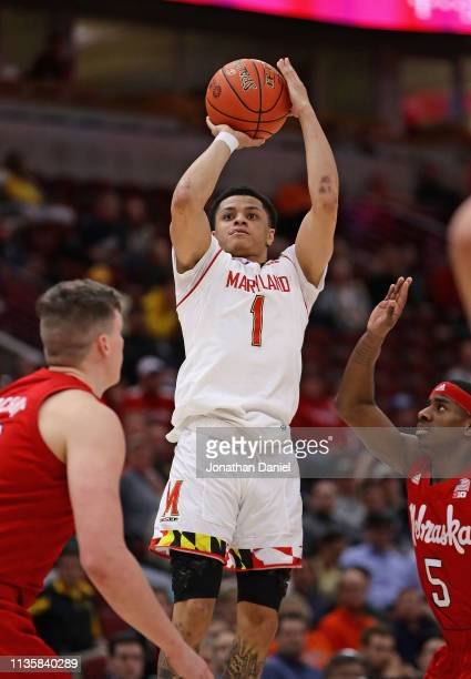 Anthony Cowan Jr #1 of the Maryland Terrapins shoots over Glynn Watson Jr #5 of the Nebraska Cornhuskers at the United Center on March 14 2019 in...