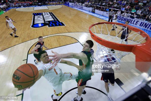 Anthony Cowan Jr #1 of the Maryland Terrapins takes a shot against Seth Adelsperger of the Belmont Bruins during the first round of the 2019 NCAA...