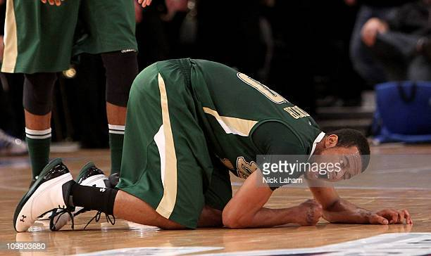 Anthony Crater of the South Florida Bulls lays on the court at the end of the first half against the Cincinnati Bearcats during the second round of...