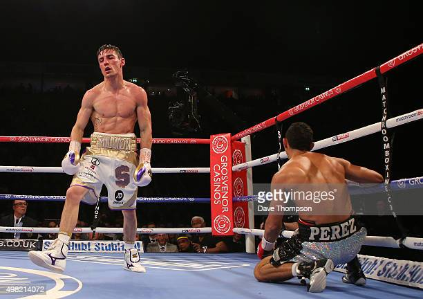 Anthony Crolla knocks down Darleys Perez during their WBA World Lightweight Championship bout at the Manchester Arena on November 21 2015 in...