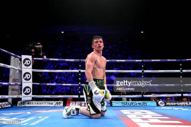 Anthony Crolla of Great Britain looks on after being knocked down by Jorge Linares of Venezuela during the WBC Diamand and Ring Magazine Lightweight...