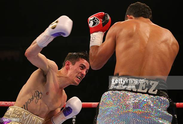 Anthony Crolla throws a punch at Darleys Perez during their WBA World Lightweight Championship bout at the Manchester Arena on November 21 2015 in...