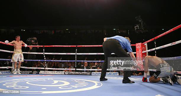 Anthony Crolla waits in the corner as Darleys Perez fails to beat the referees count during their WBA World Lightweight Championship bout at the...