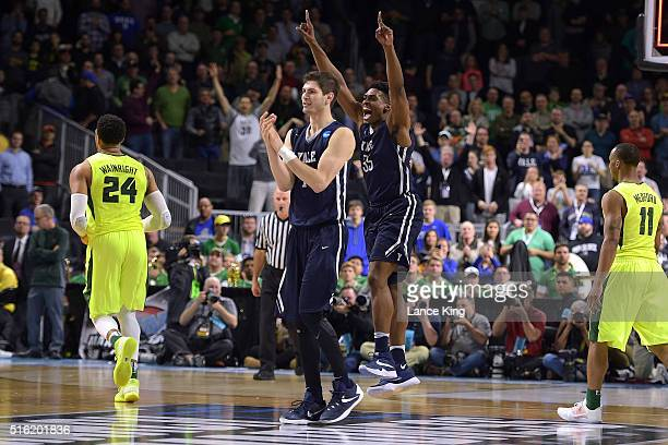 Anthony Dallier and Brandon Sherrod of the Yale Bulldogs celebrate following their 79-75 victory against the Baylor Bears during the first round of...