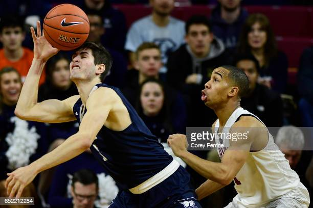 Anthony Dallier of the Yale Bulldogs bobbles the ball as Siyani Chambers of the Harvard Crimson looks on during the second half at The Palestra...