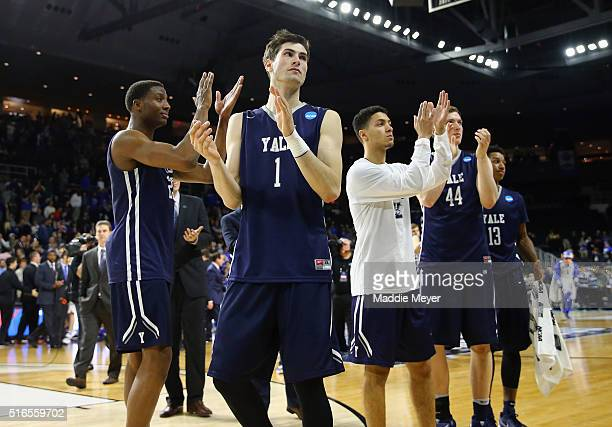 Anthony Dallier of the Yale Bulldogs reacts with teammates after being defeated by the Duke Blue Devils 7164 during the second round of the 2016 NCAA...