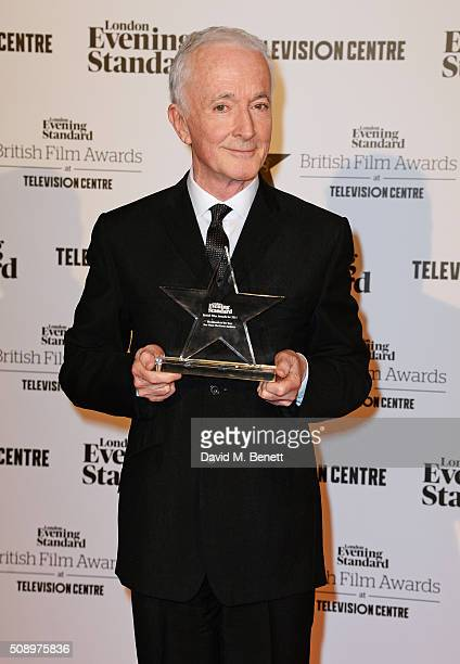 Anthony Daniels accepting the Blockbuster of the Year award for 'Star Wars The Force Awakens' poses in front of the Winners Boards at the London...