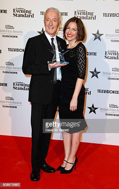 Anthony Daniels accepting the Blockbuster of the Year award for 'Star Wars The Force Awakens' and presenter Kelly Macdonald pose in front of the...