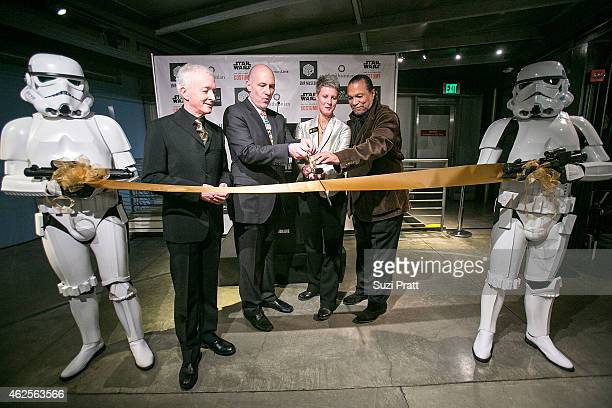 Anthony Daniels Al Hovarth Patty Isacson Sabee and Billy Dee Williams cut the ribbon at Star Wars and the Power of Costume opening exhibit at EMP...