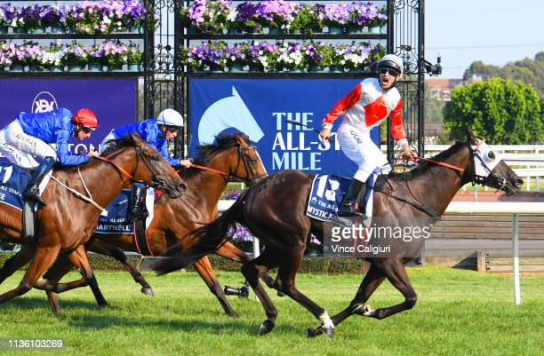 Anthony Darmanin riding Mystic Journey defeats Hugh Bowman riding Alizee and William Buik riding Hartnell in Race 8 The All Star Mile during...