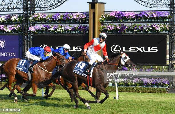 Anthony Darmanin riding Mystic Journey defeats Hugh Bowman riding Alizee and William Buik riding Hartnell in Race 8, The All Star Mile during...
