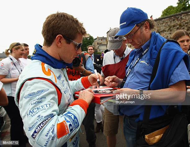Anthony Davidson of Great Britain and Aston Martin signs autographs at the drivers parade prior to the Le Mans 24h Race on June 12 2009 in Le Mans...