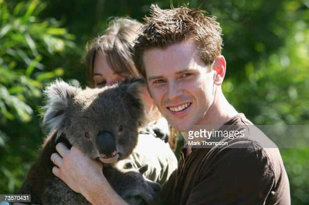 Anthony Davidson of Great Britain and Super Aguri F1 meets Mellow the koala bear at Melbourne Zoo ahead of the Australian Formula One Grand Prix on...