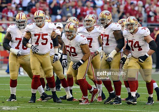 Anthony Davis Alex Boone Jonathan Goodwin Mike Iupati Joe Staley and Colin Kaepernick of the San Francisco 49ers run up to the line of scrimmage...