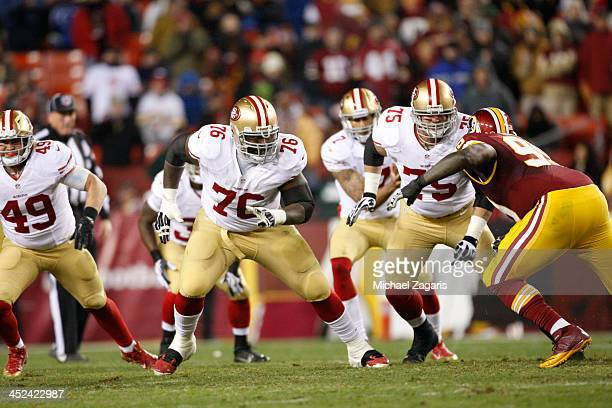 Anthony Davis and Alex Boone of the San Francisco 49ers pull to block during the game against the Washington Redskins at FedEx Field on November 25...