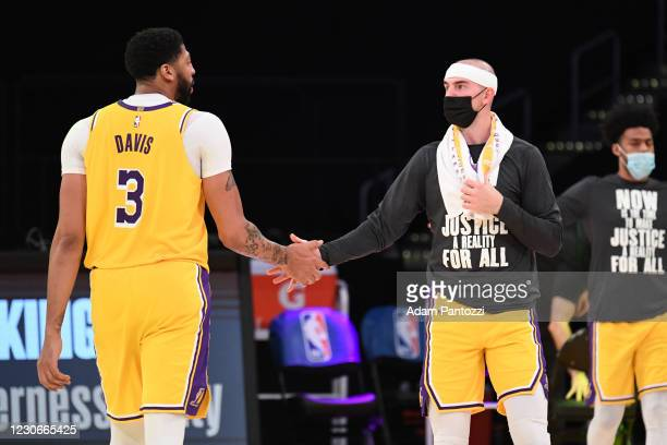 Anthony Davis and Alex Caruso of the Los Angeles Lakers hi-five during the game against the Golden State Warriors on January 18, 2021 at STAPLES...