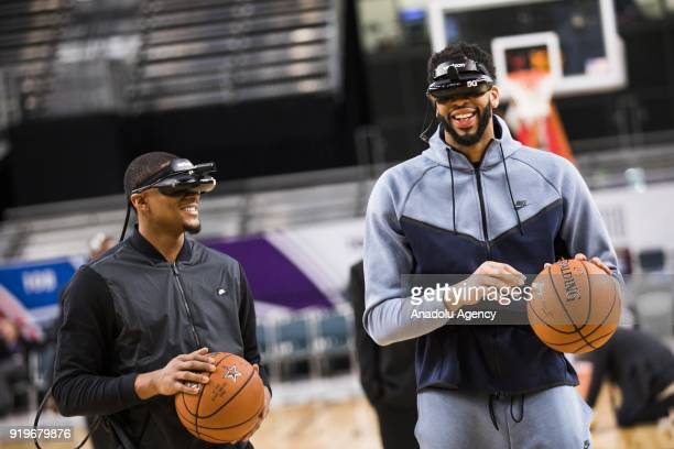 Anthony Davis and Bradley Beal of Team Lebron demo a Verizon 5G virtual reality headset after AllStar Practice as part of NBA AllStar Weekend at the...