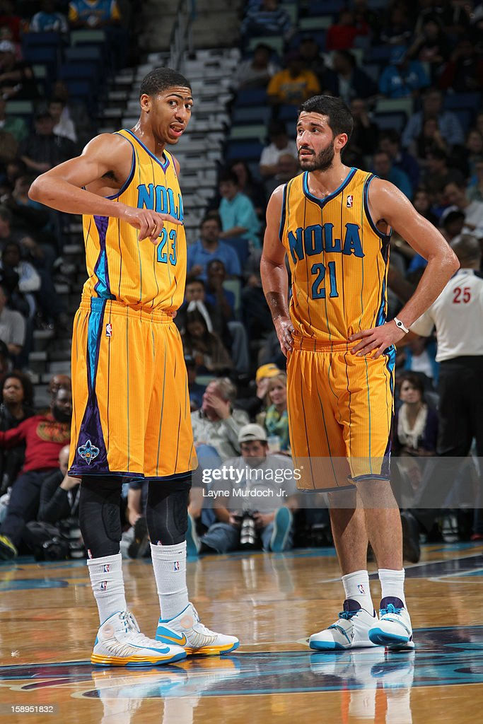 Anthony Davis #23 and Greivis Vasquez #21 of the New Orleans Hornets discuss a play against the Toronto Raptors on December 28, 2012 at the New Orleans Arena in New Orleans, Louisiana.