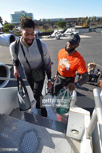 Anthony Davis and LeBron James of the Los Angeles Lakers boards the team plane as part of 2019 NBA Global Games China on October 7 2019 in El Segundo...