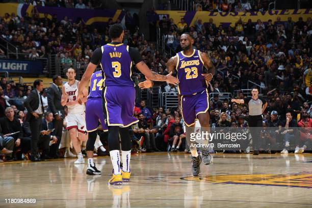 Anthony Davis and LeBron James of the Los Angeles Lakers hifive each other against the Miami Heat on November 8 2019 at STAPLES Center in Los Angeles...