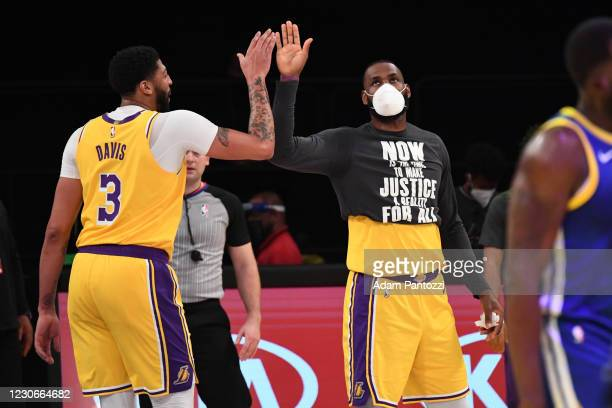 Anthony Davis and LeBron James of the Los Angeles Lakers hi-five during the game against the Golden State Warriors on January 18, 2021 at STAPLES...