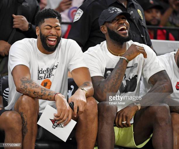 Anthony Davis and LeBron James of the Los Angeles Lakers laugh while attending Game Four of the 2019 WNBA Playoff semifinals between the Washington...