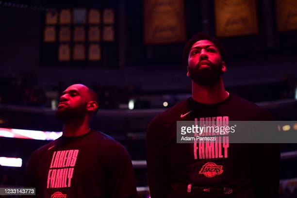 Anthony Davis and LeBron James of the Los Angeles Lakers look on before the game against the Phoenix Suns during Round 1, Game 3 of the 2021 NBA...
