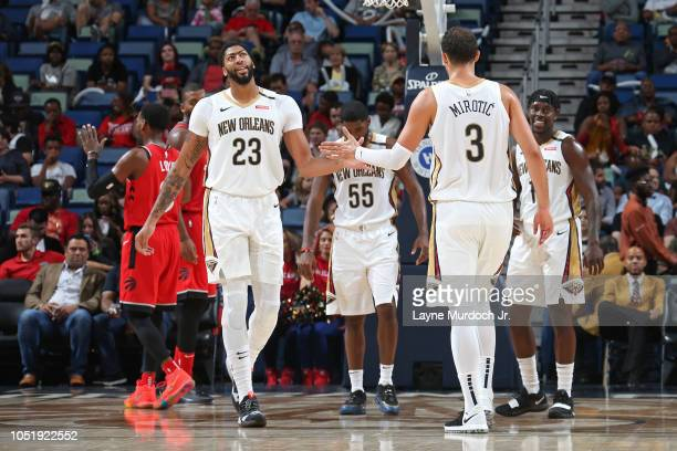 Anthony Davis and Nikola Mirotic of the New Orleans Pelicans shake hands during a preseason game against the Toronto Raptors on October 11 2018 at...