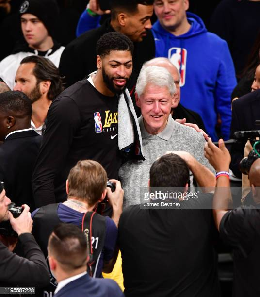 Anthony Davis and President Bill Clinton pose together after Los Angeles Lakers v Brooklyn Nets game at Barclays Center on January 23 2020 in New...