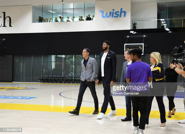 Anthony Davis arrives for the press conference to be introduced as the newest player of the Los Angeles Lakers with general manager Rob Pelinka and...