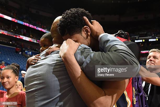 Anthony Davis embraces head coach Monty Williams after the New Orleans Pelicans clinch a playoff berth with a victory over the San Antonio Spurs at...