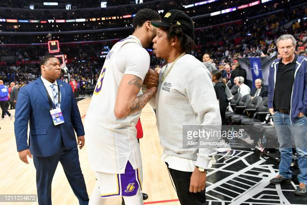 Anthony Davis greets Jay-Z after a basketball game between the Los Angeles Clippers and the Los Angeles Lakers at Staples Center on March 08, 2020 in...