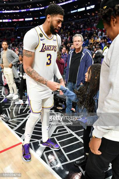 Anthony Davis greets Jay-Z and Blue Ivy Carter after a basketball game between the Los Angeles Clippers and the Los Angeles Lakers at Staples Center...