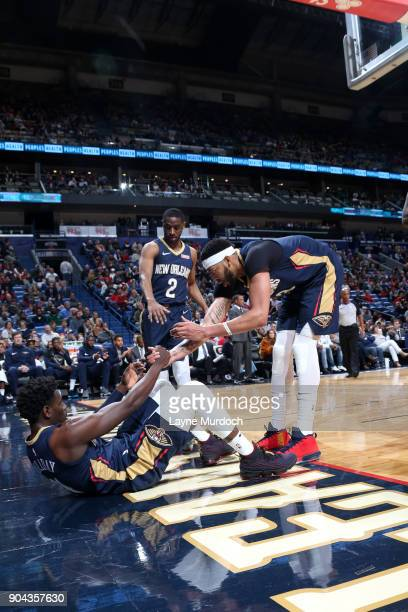 Anthony Davis helps up Jrue Holiday of the New Orleans Pelicans during the game against the Portland Trail Blazers on January 12 2018 at the Smoothie...