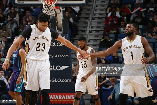 Anthony Davis high fives teammate Tyreke Evans of the New Orleans Pelicans during the game against the Charlotte Hornets on January 15 2016 at...