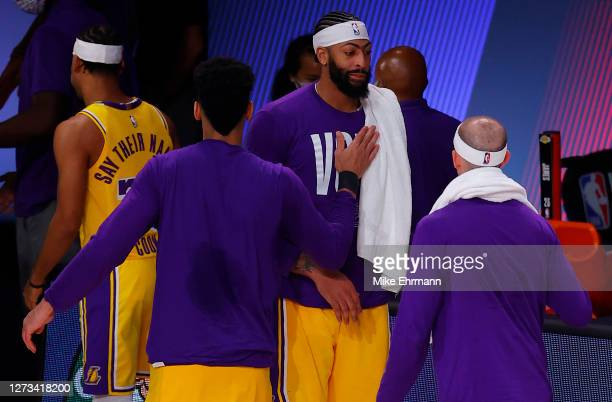 Anthony Davis is congratulated by Danny Green of the Los Angeles Lakers following a win against the Denver Nuggets in Game One of the Western...
