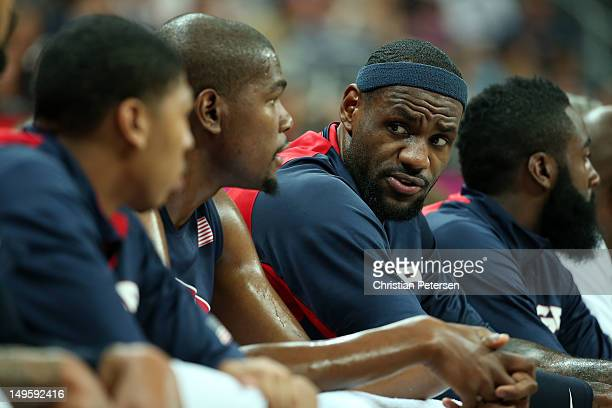 Anthony Davis, Kevin Durant, Lebron James and James Harden of United States look on from the bench against Tunisia during the Men's Basketball...