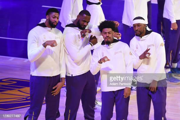Anthony Davis, LeBron James and Quinn Cook and Kentavious Caldwell-Pope of the Los Angeles Lakers pose for a photo as they get their 2019-20 NBA...