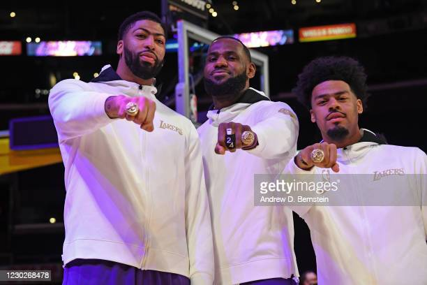 Anthony Davis, LeBron James and Quinn Cook of the Los Angeles Lakers pose for a photo as they get their 2019-20 NBA Championship ring during the ring...