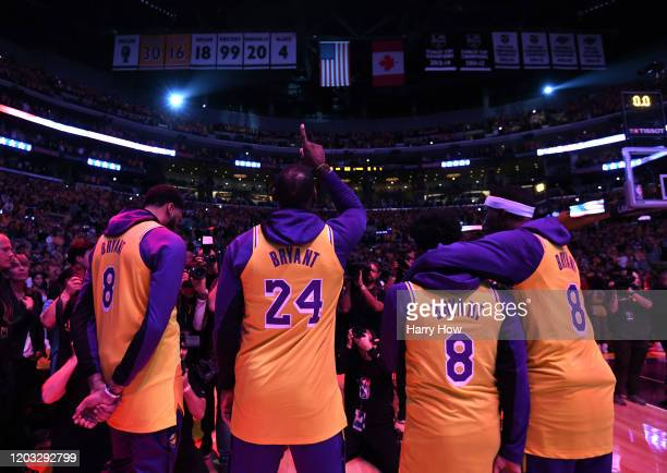 Anthony Davis LeBron James Quinn Cook and Kentavious CaldwellPope of the Los Angeles Lakers reacts at the end of the National Anthem during a...