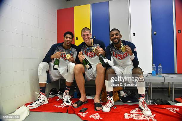 Anthony Davis Mason Plumlee and Kyrie Irving of the USA Men's National Team poses for a photo with the gold medal in the locker room after defeating...