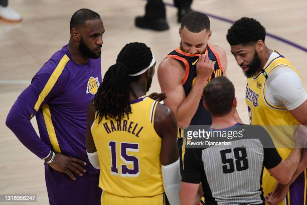 Anthony Davis, Montrezl Harrell, and LeBron James of the Los Angeles Lakers and Stephen Curry of the Golden State Warriors talk with referee Josh...
