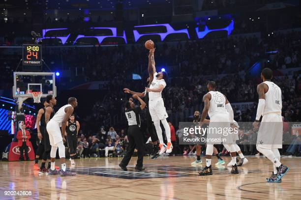Anthony Davis of Team LeBron and Joel Embiid of Team Stephen jump for the tipoff during the NBA AllStar Game 2018 at Staples Center on February 18...