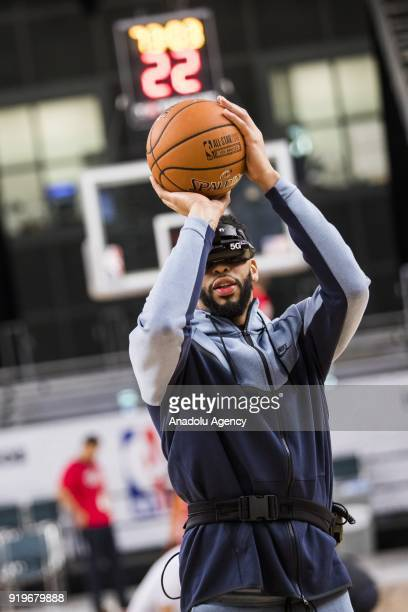 Anthony Davis of Team Lebron demos a Verizon 5G virtual reality headset after AllStar Practice as part of NBA AllStar Weekend at the Convention...