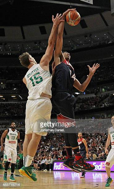 Anthony Davis of team USA rebounds over Tiago Splitter of team Brazil during an exhibition game at the United Center on August 16 2014 in Chicago...