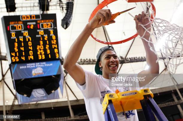 Anthony Davis of the Kentucky Wildcats cuts down the net after they defeated the Baylor Bears 82 to 70 during the 2012 NCAA Men's Basketball South...