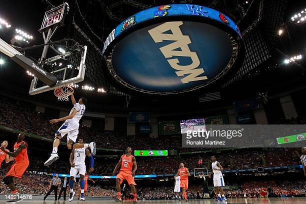Anthony Davis of the Kentucky Wildcats dunks the ball late in the second half against the Louisville Cardinals during the National Semifinal game of...