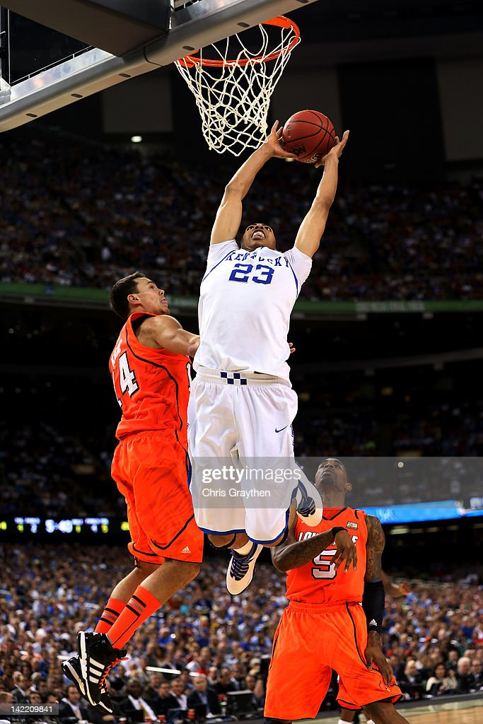 Anthony Davis #23 of the Kentucky Wildcats goes up for a dunk over Kyle Kuric #14 of the Louisville Cardinals during the National Semifinal game of the 2012 NCAA Division I Men's Basketball Championship at the Mercedes-Benz Superdome on March 31, 2012 in New Orleans, Louisiana.