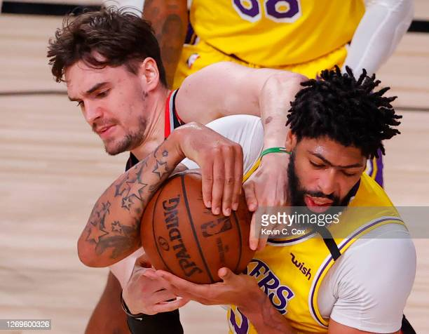 Anthony Davis of the Los Angeles Laker strips the ball from Mario Hezonja of the Portland Trail Blazers during the third quarter in Game Five of the...