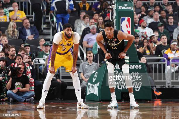 Anthony Davis of the Los Angeles Lakers and Giannis Antetokounmpo of the Milwaukee Bucks look on during a game on December 19 2019 at the Fiserv...